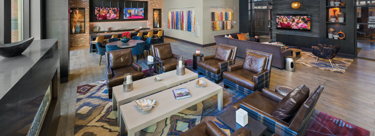 Remy clubroom with TVs, kitchen and seating