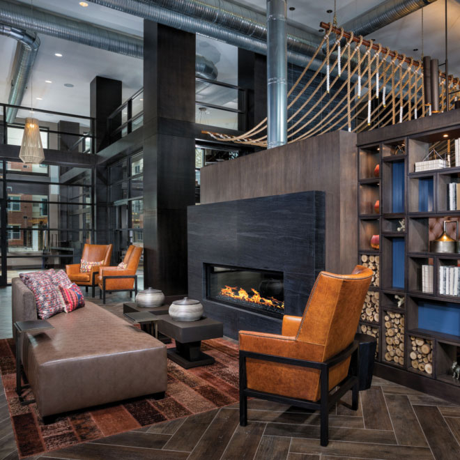 Remy clubroom with fireplace and seating